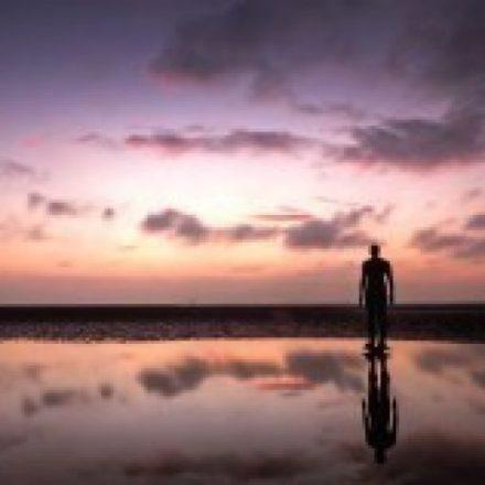 man-beach-dawn